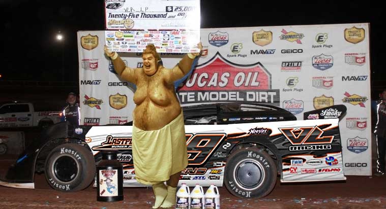 VLR_LP poses in victory lane after winning at Outlaw!